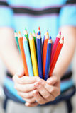 Pencils in children's hands Stock Images