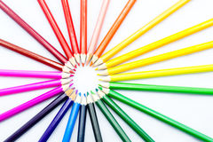 Pencils in a circle. Colorful pencils in a circle on the white background Royalty Free Stock Photo