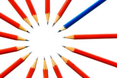 Pencils in a cirlce. Red led pencils in a cirlce with a blue colored pencil standing out as the old one in the group Royalty Free Stock Photos