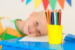 Little boy draw with colored pencils.Pencils close up. stock images