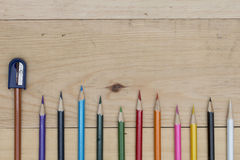 Pencils color and sharpener on wood table Royalty Free Stock Photography