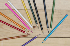 Pencils color on wood table Stock Photos