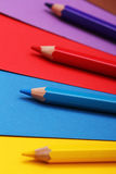 Pencils on colorful paper royalty free stock photography