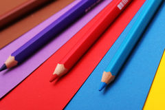 Pencils on colorful paper royalty free stock images