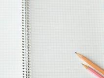 Pencils on copy-book Stock Photos