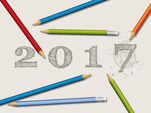 Pencils and corrected 2016 text. Background with pencils and corrected 2017 text Stock Image