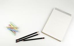 Pencils, crayons, note pad - free space for text Stock Photos