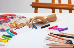Pencils, crayons and paints Stock Photos