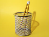 Pencils in Cup. Photo of Pencils In Cup With Yellow Background - Part of Series royalty free stock photos
