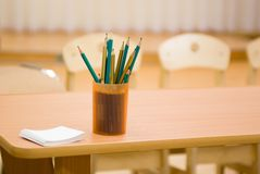Pencils in a cup on the edge of the table Stock Photo