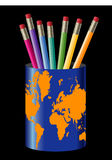 Pencils in cup with globe Royalty Free Stock Image