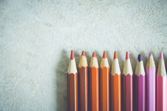 Pencils of different colours. On the white table. Toned image Stock Photos