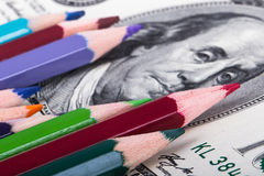Pencils on Dollar Banknote Royalty Free Stock Images