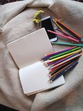 Pencils for drawing in a notebook. Write a congratulatory text in a notebook in colorful pencils Royalty Free Stock Images