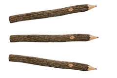 Pencils for drawing from a tree branch separately. On a white background Royalty Free Stock Images