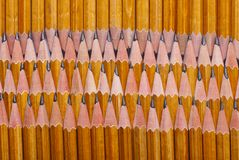 Pencils edge of each other vertically Royalty Free Stock Photos