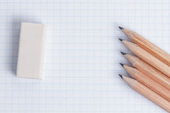 Pencils and eraser on notebook page Royalty Free Stock Images