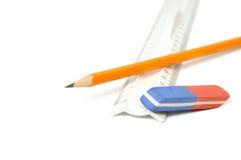 Pencils, eraser and ruler stock images