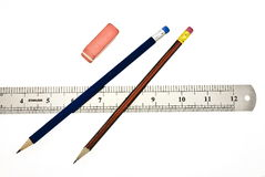Pencils, eraser and ruler. On white Stock Photos