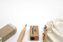 Pencils, erasers, pencil sharpeners and fabric bag Stock Image