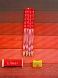 Pencils erasure and sharpener Stock Photos
