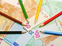 Pencils and euro Stock Photography