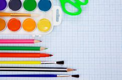 Pencils, felt pens on graph grid paper Stock Photo