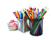 Pencils and felt-tip pens in baskets. Stock Image