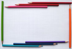 Pencils frame. Colorful pencils frame on blank paper sheet Royalty Free Stock Image