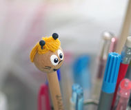 Pencils. A funny cartoon on top af a pencil Royalty Free Stock Photos