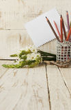 Pencils in the glass and flowers, selective focus Royalty Free Stock Photography