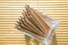 Pencils in a glass at the office. Bunch of pencils in a glass on the office table Royalty Free Stock Photo
