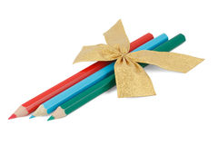 Pencils with a golden bow Royalty Free Stock Photo
