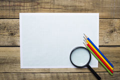 Pencils, graph paper and magnify in business planing concept Royalty Free Stock Photography