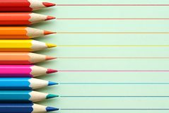 Pencils on green background. stock photo