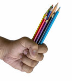 Pencils in hand Stock Photography