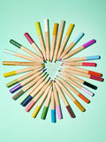 Pencils and heart Stock Image