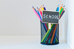 Pencils in a holder on the light-coloured shelf Royalty Free Stock Images