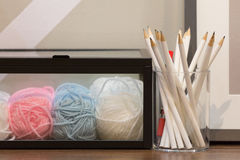 Pencils and knitting balls Royalty Free Stock Photography
