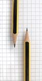 Pencils laying on sheet Royalty Free Stock Photos