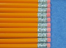 Pencils laying in a straight line stock photos