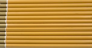 Pencils lined up Royalty Free Stock Images