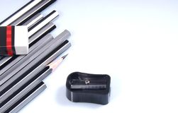 Pencils, manual sharpener and eraser Stock Photos