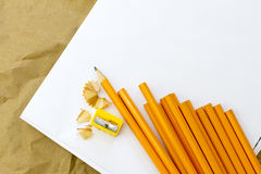 Pencils. Many crayons lie on the sheet of paper Royalty Free Stock Photo