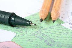 Pencils and marker on a  map Stock Photography
