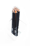 Pencils in the meshy box on white background Stock Image