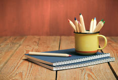 Pencils in a mug on a wooden table Royalty Free Stock Photo