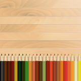 Pencils multicolored autumnal, wooden background Stock Photos