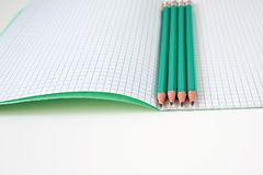 Pencils next to the school notebook royalty free stock images