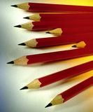 Pencils. Nine red pencils - A pencil is an instrument for writing or drawing, consisting of a thin stick of graphite or a similar substance enclosed in a long Stock Photography